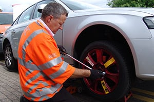 Patrol man fitting the universal spare wheel