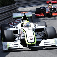 Button roars Brawn to victory