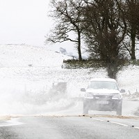 Looming snow threatens road users