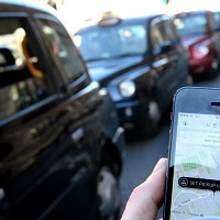 Cabbies block London in Uber row