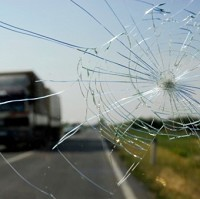 Window smashed in stone attack