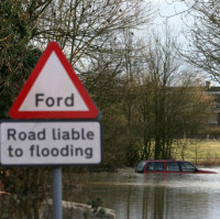 Trapped driver rescued from flooded ford