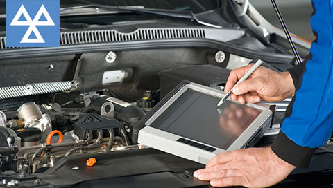 Mechanic running a diagnostic check on a car